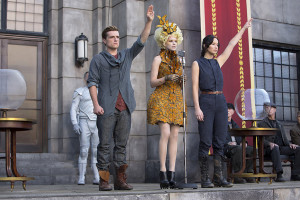 """Katniss (Lawrence) and Peeta (Hutcherson) are chosen to return to the games, but must battle past victors while struggling to keep each other alive. Love, action, suspense, and astounding visuals make """"Catching Fire"""" the perfect """"Hunger Games"""" sequel."""