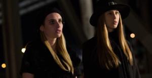 Madison (Emma Roberts) and Zoe (Taissa Farmiga) warn Queenie (Gabourey Sidibe) of the impending war.