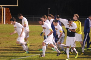 """Steinbrenner heads back onto the field after their last water break. The Warriors made some """"key changes"""" which led to them winning the game, 4-3 in overtime."""