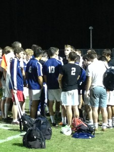Steinbrenner players crowd around their captains to hear words of encouragement after their devastating loss to East Lake.