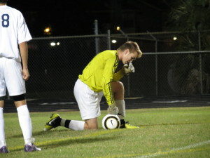Steinbrenner goalkeeper Christian Knight kneels after making a save. He signed with the University of Tampa wednesday.