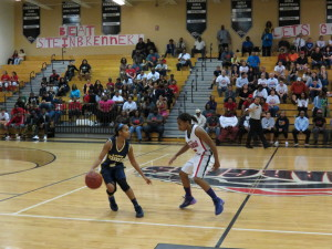 Steinbrenner's Taylor Thigpen (left) works the ball up the court against Strawberry Crest's Nandi Jorden. Thigpen scored 12 points en route to her teams 50-38 win.