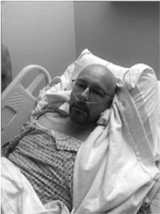 Physics teacher James Liberatore upon waking up from surgery on Dec. 23, 2013. Local surgeon, Dr. David Echevarria performed the life-saving operation where a tumor was removed from Liberatore's intestinal wall.