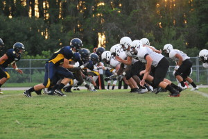 The Warriors line up at the line of scrimmage against the Sunlake Seahawks in Friday nights match. The Warriors went on to win the game 20-9.