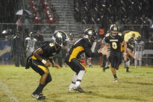 Steinbrenner offense sets up for a play. Despite the constant rain there were no delays during the game.
