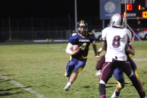 Quarterback Quentin Poteralski runs for a first down against Wiregrass. Poteralski ran for over 110 yards on the night.
