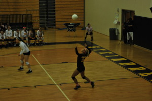 Senior Defensive Specialist Caroline Pomet serves to the Charger defense in the first set. When Pomet served the Warriors scored seven total points.