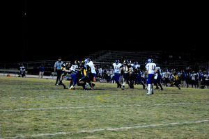 The Warrior defense tackles Jefferson on a third down try. The Warriors force Jefferson to punt three times on the night.