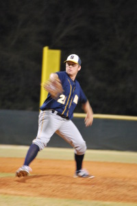 LHP Andrew Lindsay in motion pitches the ball in the bottom of the 1st inning in Wednesday's makeup game against Sickles. Lindsay drove in one RBI in the top of the first and threw 95 pitches for a complete game shutout, 2-0, Steinbrenner.