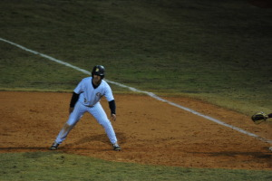 Colby Burchardt leads off first as he prepares to steal second base thus positioning himself to score off a hit from Brandon Johnson. Burchadrt scored the winning and only run in the game in the bottom of the ninth.