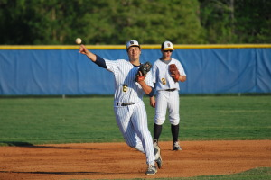 Colby Burchardt takes a ball and throws to first during Friday's event. They beat Sickles 4-2 and Burchardt drove in a run in the bottom of the first.