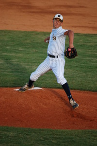 CJ Van Eyk pitches a ball during the top of the third inning Tuesday night against Durant in the 7A Region Semi-Finals. He went seven strong innings showing one of his best performances all year.