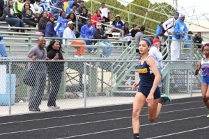Track and field member, senior Chanel Marchena takes the lead in this particular race against King High School. With administration still weighing their options as to whether or not to install a new rubber track, pre-exisitng and even graduating team members are nonetheless excited.