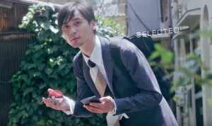 A moment in the trailer of a man summoning a Pokeball to capture a Pokemon. (Youtube)